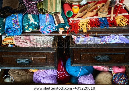 Chest with woven textiles made of textile - stock photo