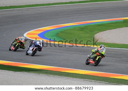 CHESTE, SPAIN  - NOVEMBER 6: Maverick Viñales (25), Hector Faubel (55) and Nico Terol (18) participating at final race of MotoGP Grand Prix 2011 on November 6, 2011 in Cheste (Valencia), Spain