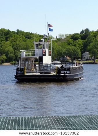Chester Hadlyme Ferry approaching the dock on the Chester side of the Connecticut River - stock photo