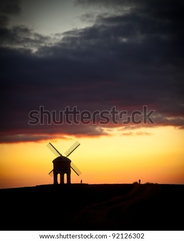 Chesterton Windmill at sunset with onlookers - stock photo