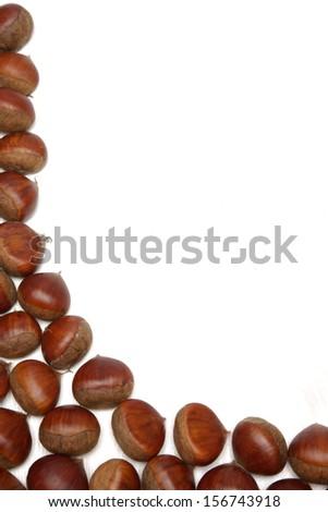 Chestnut arranged on white background - stock photo