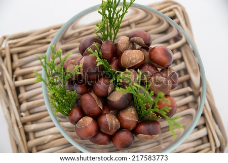 Chestnut on wooden wicker basket.