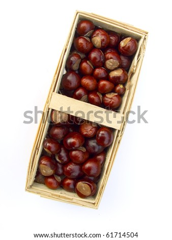 chestnuts in a basket isolated on white background - stock photo
