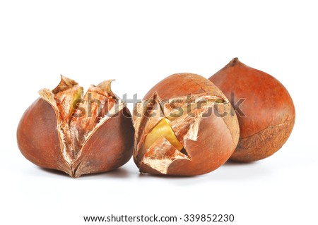 Chestnuts isolated on white - stock photo