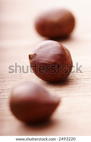 chestnuts lined up on cloth, focus on the middle one