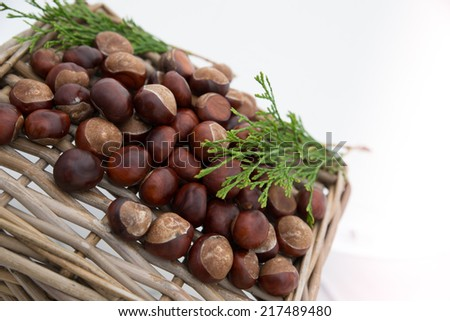 Chestnuts on a wicker basket.