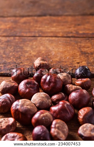 Chestnuts on a wooden table.