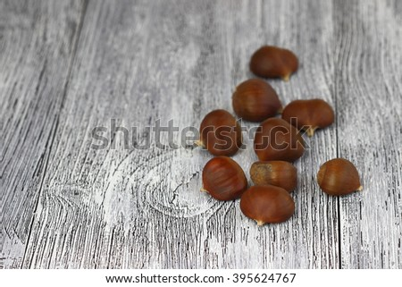 chestnuts  on the old wooden table