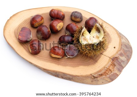 Chestnuts on  wood - isolated on white                     - stock photo