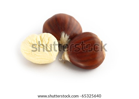Chestnuts over a white background. - stock photo