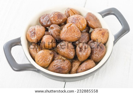 Chestnuts - Peeled and cooked chestnuts on a white background. - stock photo