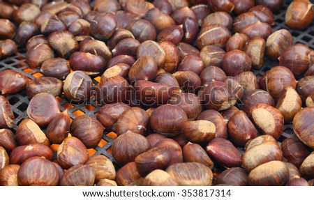 chestnuts roasted on the fire from a street vendor on the road in winter