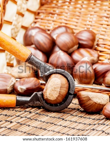Chestnuts with a basket and a nutcracker