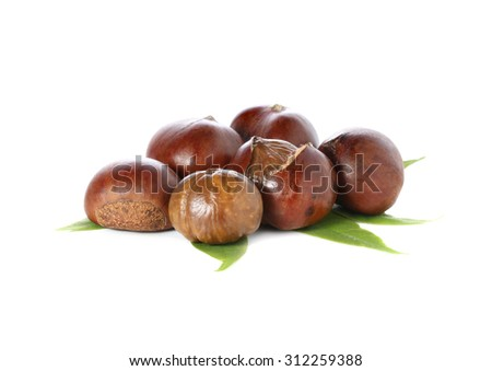 Chestnuts with chestnut leafs isolated on white