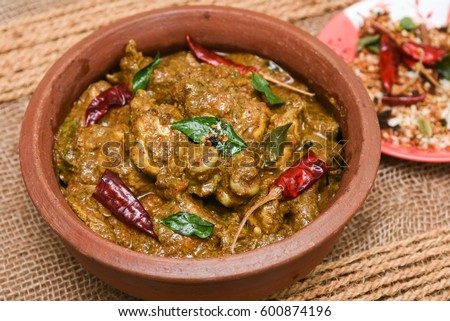 Chettinad chicken curry hot spicy dish stock photo image royalty chettinad chicken curry is a hot and spicy dish tamil nadu south india gravy forumfinder Image collections