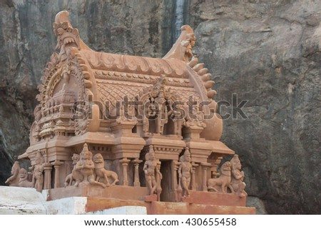 Chettinad, India - October 16, 2013: At the foot of  the Thirumayam fort and against the rock cliff stands a Vishnu shrine. Focus on Vimanam.  - stock photo