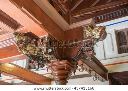 Chettinad, India - October 17, 2013: Chidambara Palace in Kadiapatti. One of many decorated wooden capitals on top of in-house pillars. - stock photo