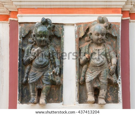 Chettinad, India - October 17, 2013: Chidambara Palace in Kadiapatti. Two of a series of identical Krishna statues on plinth traversing the entire front facade. - stock photo