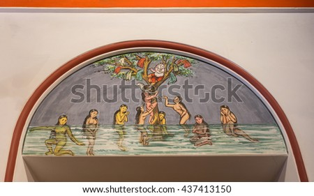 Chettinad, India - October 17, 2013: Chidambara Palace in Kadiapatti. Wall painting above door showing Krishna hiding in tree after stealing clothes of bathing naked Gopi girls. - stock photo