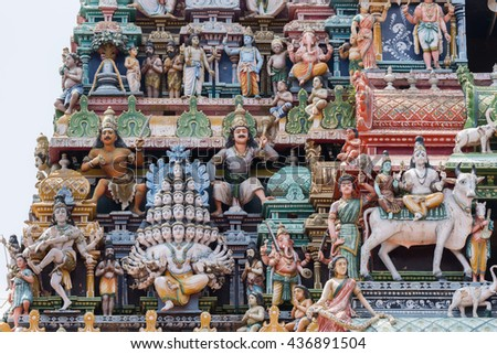 Chettinad, India - October 17, 2013:Detail of the Shiva temple gopuram at Kottaiyur shows Lord Shiva as Maha Sadashiva Murthy with 25 heads. Dancing Shiva, too, and many colorful statues. - stock photo