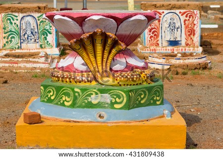 Chettinad, India - October 17, 2013: Set of three colorful altars on square in Kothamangalam. First one shows lotus and five headed cobra. The other altars are for Lord Ganesha and Lord Ayyanar. - stock photo