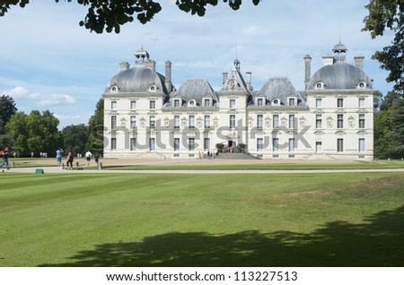 CHEVERNY, FRANCE - AUGUST 16: Castle on August 16, 2012 in Cheverny: Tourists walk in the castle of Cheverny. Built in the 17th century inspired by the work of the best artists of the time.