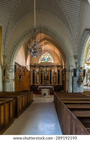 CHEVERNY, FRANCE - JUNE 10, 2015: Interior of Saint Etienne church - lovely little 12th century church opposite the entrance to Chateau de Cheverny castle.