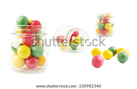 Chewing gum balls and glass jar composition, isolated over the white background - stock photo