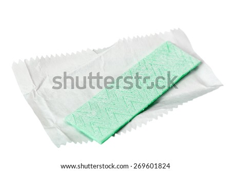chewing gum is on the white background with paper. focus in the middle of the frame, shallow depth of field - stock photo