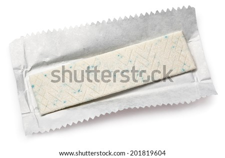 Chewing gum plate on wrapping paper isolated on white - stock photo