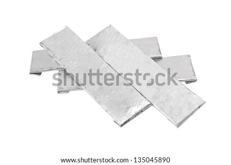 chewing gums wrapped in standard silver foil, isolated on white