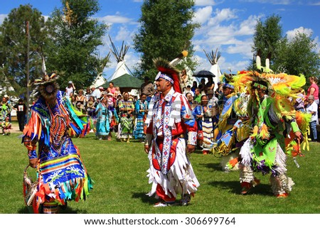 CHEYENNE, WYOMING - July 25, 2015 - Native American performers in costume and dancing at a pow-wow - stock photo