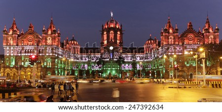 Chhatrapati Shivaji Terminus (CST) formerly Victoria Terminus in Mumbai, India is a UNESCO World Heritage Site with colourful lighting of Indian flag on Republic Day, the HQ of the Central Railway. - stock photo
