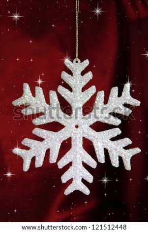 Chhristmas snowflake on bordeaux  background - stock photo