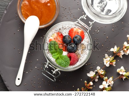 Chia pudding dessert with berries and honey - stock photo