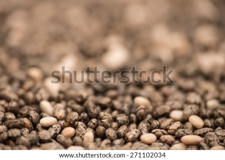 Chia seeds background, macro shot with selective focus - stock photo