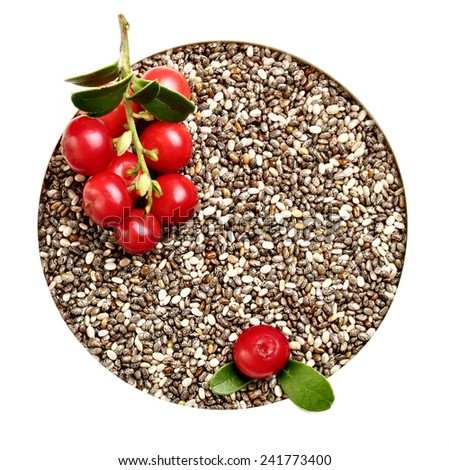 Chia seeds closeup and forest berries, cowberry . - stock photo
