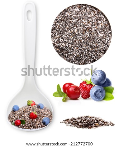 Chia seeds closeup in white spoon and forest berries. - stock photo