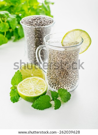 Chia seeds drink with water in transparent glass with lime and lemon balm. selective Focus - stock photo