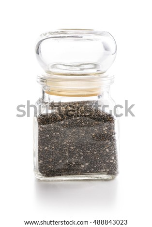 Chia seeds in jar isolated on white background. Healthy superfood.