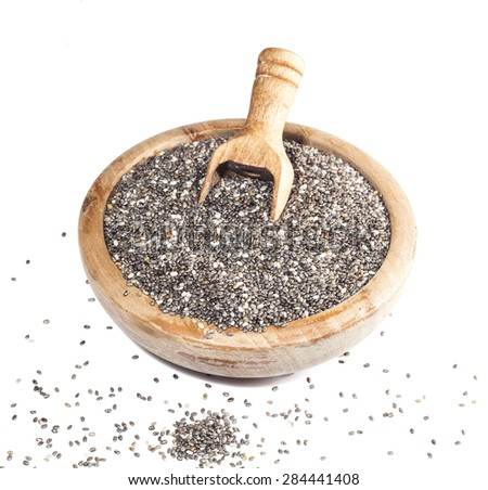 Chia seeds in wooden bowl and spoon isolated on white background. - stock photo