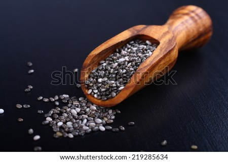 Chia seeds in wooden scoops, one of the superfoods - stock photo