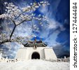 chiang kai shek memorial hall in taiwan with nice sakura flower - stock photo