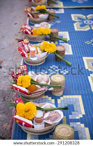CHIANG KHAN, THAILAND - JUNE 27, 2015: Unidentified tourists offering sticky rice to Buddhist monk and Buddhist novice in the morning on June 27, 2015 in Chiang Khan, Loei, Thailand. - stock photo
