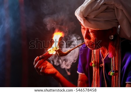 Chiang mai July 17 2015 Smoke for karen hill tribe is smoking tobacco pipe traditional