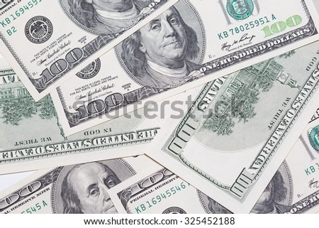 Chiang Mai, Thaialnd - Octoberber 9,2015 : Photo of dollar bills on the table. Studio lighting photography. - stock photo