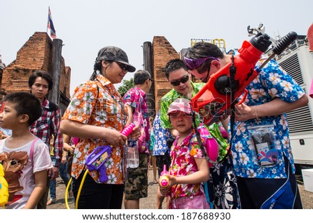 CHIANG MAI THAILAND - APRIL 13 : Chiangmai Songkran festival.Unidentified men and women traveler Like to join the fun with splashing water at Tha Pae road.on April 13,2014 in Chiangmai,Thailand.