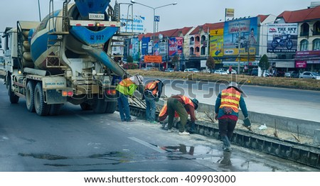 CHIANG MAI, THAILAND-APRIL 23,2016:Construction workers installing new utilities pour concrete  - stock photo
