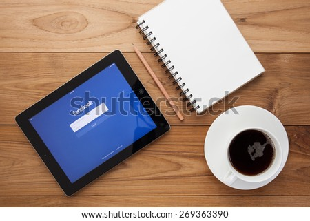 CHIANG MAI, THAILAND - April 8, 2015: Facebook application sign in page on Apple iPad. Facebook is largest and most popular social networking site in the world. - stock photo