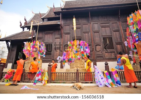 CHIANG MAI THAILAND - APRIL 13 : In Songkran festival or Water festival, Buddhist monk pin traditional flags on sand pagoda. APRIL 14,2012 in Phan-Tao Temple, Chiangmai province, Northern Thailand. - stock photo